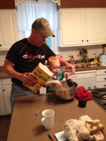 "Helping ""G-pa"" make pancakes"