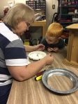 Helping Grandma Toni fix a clock